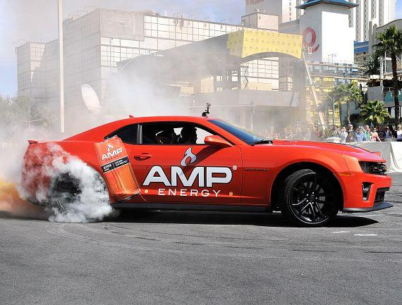 AMP Energy driver Dale Earnhardt Jr. celebrated the return of AMP Energy Orange with the ultimate orange burnout at Caesars Palace on Wednesday, March 6, 2013.