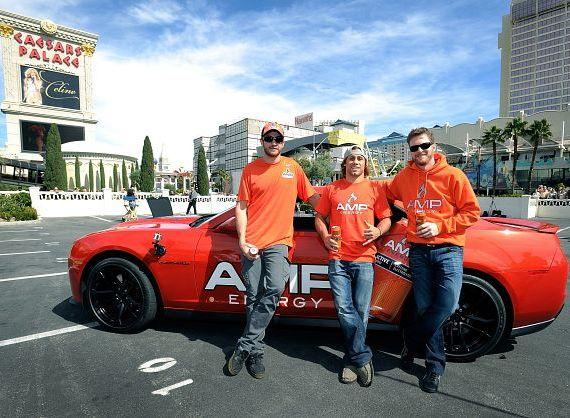 Dale Earnhardt Jr. teamed up with fellow AMP Energy athletes, Urijah Faber and Scotty Lago, to teach them how to perform the ultimate orange burnout in front of Caesars Palace on Wednesday, March 6, 2013.