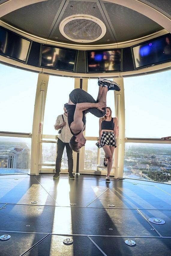 A member of the acrobat group AcroArmy performs a backflip 550 feet in the air on the Las Vegas High Roller