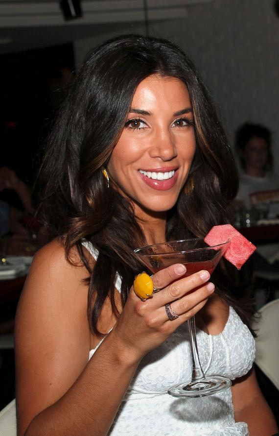 Adrianna Costa with STK's diamond and pink sapphire encrusted steak knives