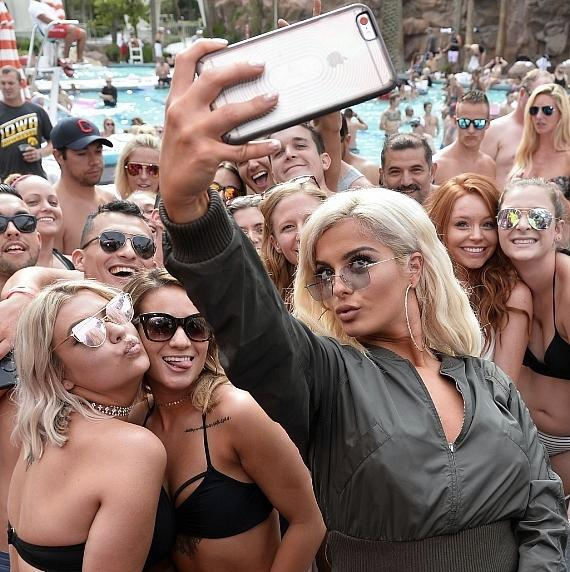 Singer/Songwriter Bebe Rexha takes selfies with fans at the Flamingo GO Pool in Las Vegas