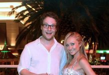 Seth Rogen poses with a server at Surrender Nightlclub