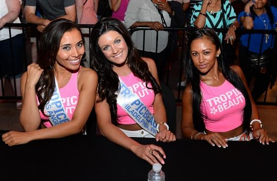 TropicBeauty 2014 contestants Brittani Johnson of California, Ashley McKinney of Pennsylvania and Annielou Landino of the Phillippines sign autographs during the Tropic Beauty meet-and greet sponsored by Rain Cosmetics at The D Las Vegas