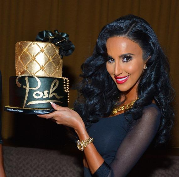 Lilly Ghalichi poses with her cake at Posh Boutique Nightclub