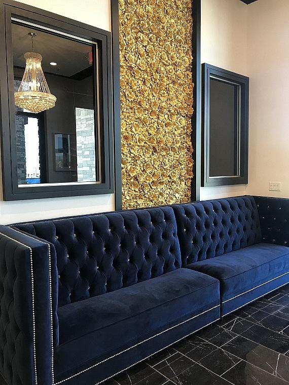 Blume Restaurant Entry with Accent Wall of Handmade Silk Flowers