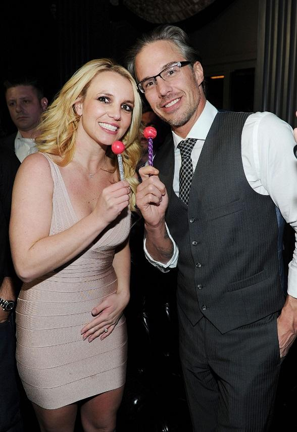 Britney Spears and Jason Trawick pose with matching couture pops from Sugar Factory