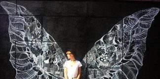 Taylor Swift poses with a pair of wings entitled What Lifts You?