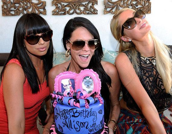 Cheryl Burke, Allison Melnick and Paris Hilton attend Melnick's birthday celebration at Daylight Beach Club at the Mandalay Bay Resort & Casino
