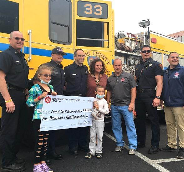 The Clark County Firefighter's Union, Local 1908, presents $5,500 check to Cure 4 The Kids Foundation