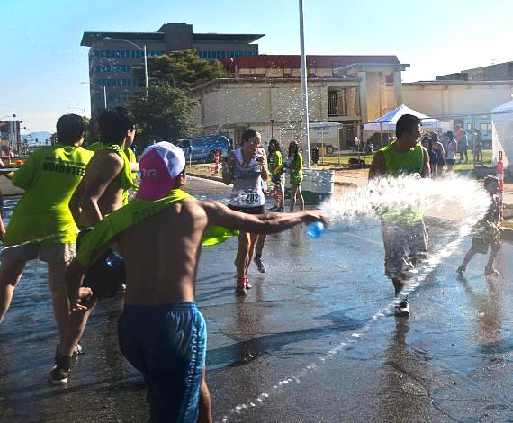 Runners get doused with water during Inagural Spinkler Sprint 5K in Downtown Las Vegas