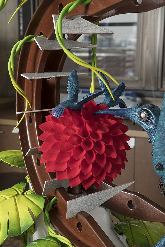Cheveau's winning showpiece was an artistic representation of how construction and industrialization can encroach on natural environments. The vibrant sculpture depicted robotic bright blue hummingbirds drawing nectar from man-made red flowers growing along steel wires.