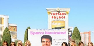 Paying tribute to boxing legend Muhammad Ali, Sports Illustrated models pose next to Ali's 8-foot SI cover.