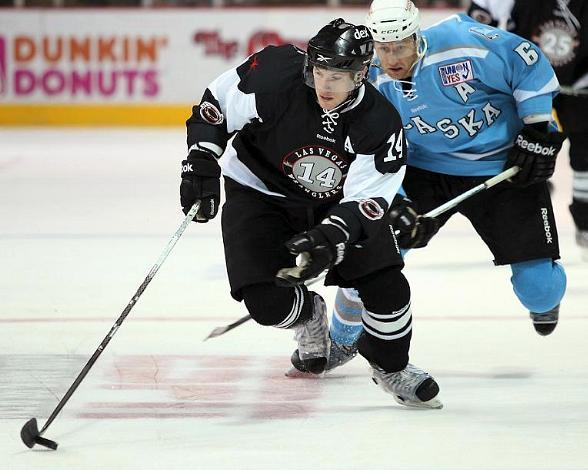 Wranglers center Scott Campbell controls the puck against the Alaska Aces