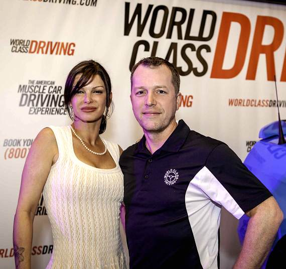 Carla Pellegrino and World Class Driving CEO Aaron Fessler at American Muscle Car Launch Party