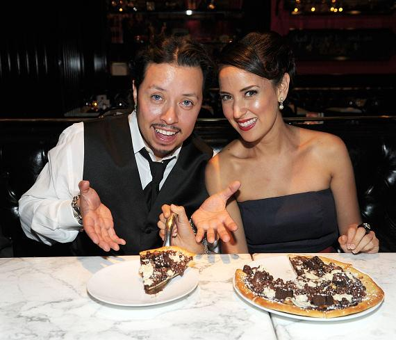 Carlos Ramirez with girlfriend, Burgundi Phoenix, trying the chocolate dessert pizza at Sugar Factory American Brasserie in Las Vegas