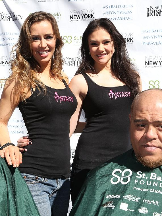 Cast members of FANTASY pose for a photo before shaving heads at New York-New York's 6th annual St. Baldrick's Event