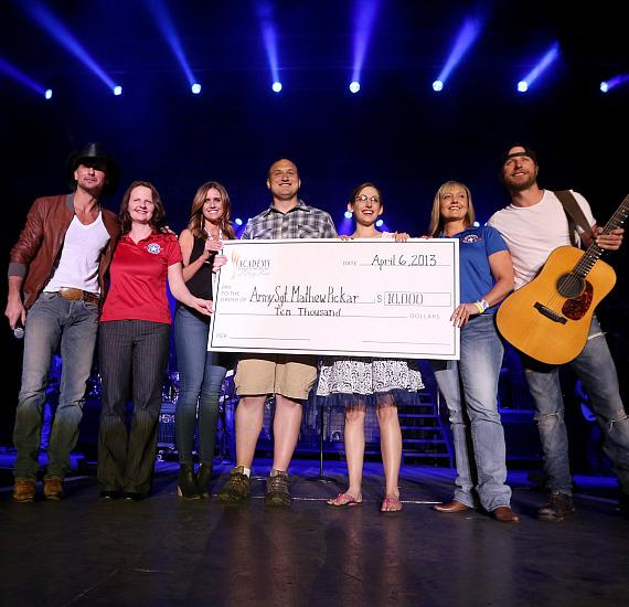 Check presentation with Army Sgt. Mathew Pickar and Dierks Bentley