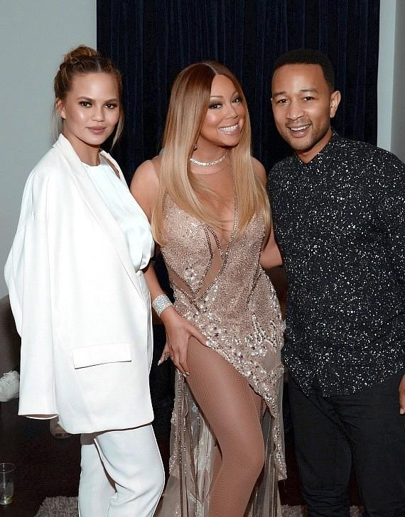 "Chrissy Teigen and John Legend at ""Mariah #1 to Infinity"" at The Colosseum at Caesars Palace"