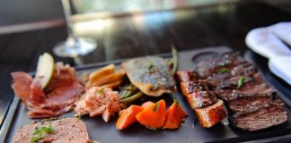 From left to right, Comme Ca's house-made charcuterie, Merguez Sausage and Skirt Steak au Poivre.
