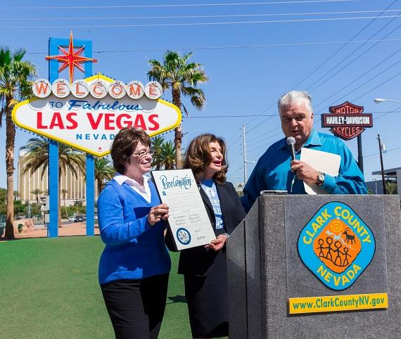 Commissioners Scow and Sisolak presenting proclamation
