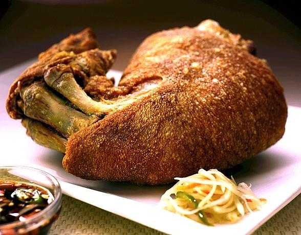 Max's Signature Crispy Pata Featured in the Desert Companion Magazine Summer Dining Issue