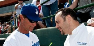 Los Angeles Dodgers' Manager Don Mattingly signs autographs for Chef Barry