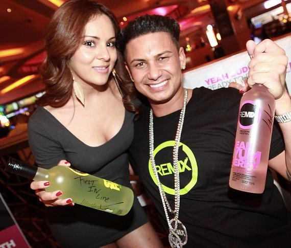 DJ Pauly D hangs out with fans and signs bottles of his pre-game vodka based cocktail Remix