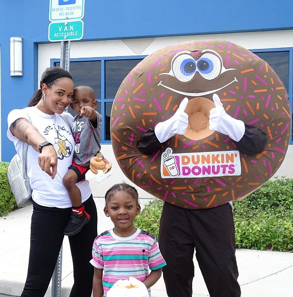 "Family poses with ""Sprinkles"" of Dunkin' Donuts at Nevada Childhood Cancer Foundation"
