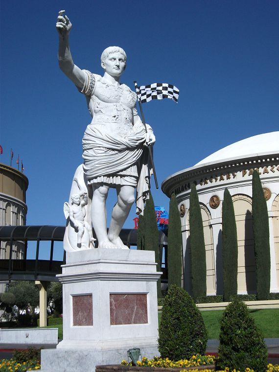Caesar waiving the distinguished checkered flag along the famed Las Vegas Boulevard
