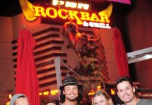 """Cast members of Thunder from Down Under with co-host Christina """"CC"""" Christensen at PBR Rock Bar"""