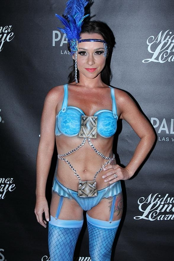 """""""Scream Queen"""" Danielle Harris Tantalizes Partygoers in Body-Painted Costume at Midsummer Lingerie Masquerade at Palms Pool"""