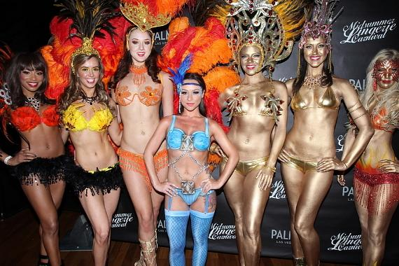 Danielle Harris poses with Midsummer models at the Carnival-inspired lingerie bash at Palms Pool