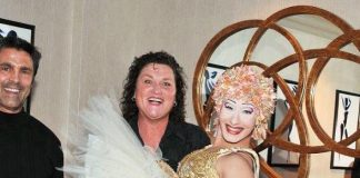 """Dot Jones of Glee enjoys a playful moment with one of """"O's"""" signature artists, the ballerina"""