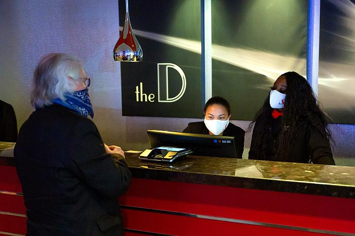 Downtown Las Vegas visitor checks-in at the recently reopened D Las Vegas - Photo Credit: Black Raven Films