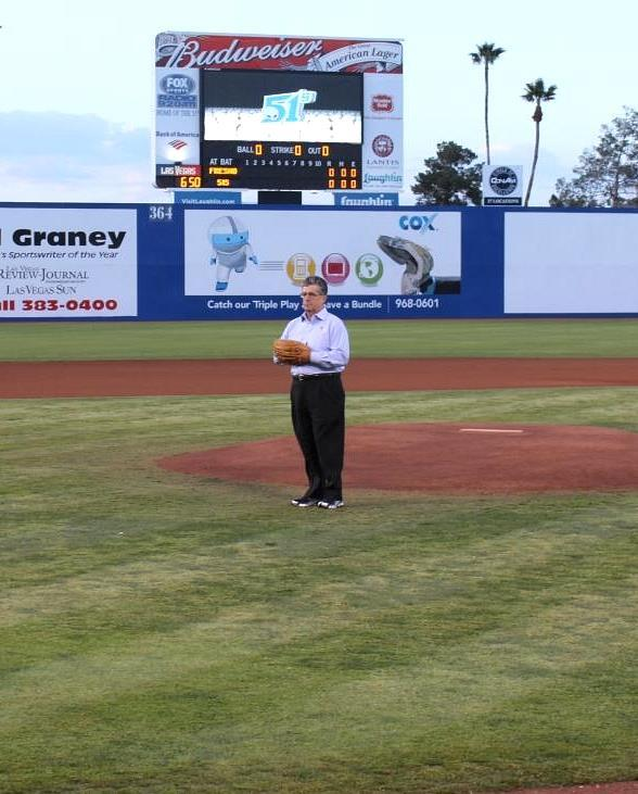 Senior Provost Dr. Michael Harter throws out the first pitch