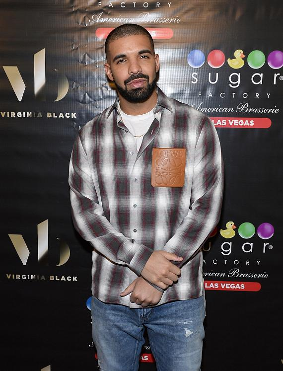 Drake poses for pictures on red carpet at Sugar Factory in Las Vegas