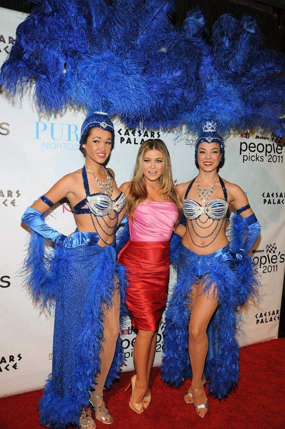 Carmen Electra with showgirls on red carpet at PURE Nightclub