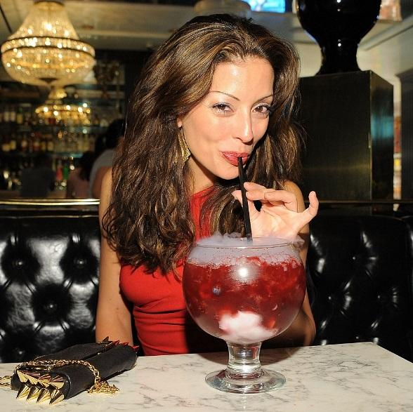 Emmanuelle Vaugier sipping on a Berry Bliss Goblet