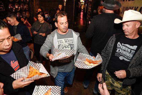 Evel Pie General Manager Joey D_Amore serves up slices to guests