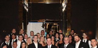The staff of FIZZ Las Vegas, with Owner Steve Kennedy, Creative Director David Furnish and Owner Michael Greco front and center, prepare to welcome their first guest, kicking off the venue's soft opening.