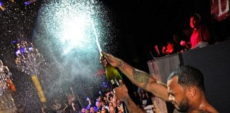 Flo-Rida sprays fans with champagne during live performance at Chateau Nightclub & Gardens
