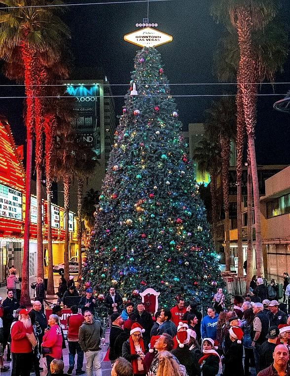 olyn Goodman and Patrick Hughes celebrate the holiday season with official Christmas tree lighting