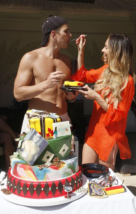Giuliana and Bill with birthday cake at Azure Luxury Pool