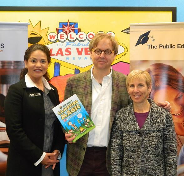 Harrah's Las Vegas Comedy-Magician Mac King donates an autographed copy of his book Campfire Magic to the Edith Garehime Elementary School library during his visit to the school as part of Mac King's Magical Literacy Tour: Nevada Reading Week 2012. Pictured left to right Hergit Llenas - Director of Clark County READS, Mac King – Harrah's Headliner and Comedy-Magician, Shelley Kresyman – Principal at Edith Garehime Elementary School.