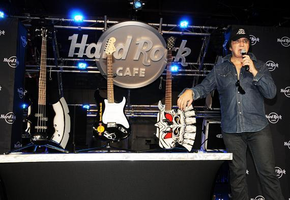 Gene Simmons shows the guitars being donate to Hard Rock Cafe