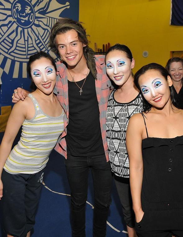"""Harry Styles of One Direction takes time to visit with the contortionists of """"O"""" during a visit to see the show on Thursday, Aug. 2."""