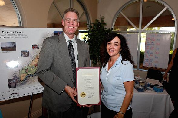 """City of Henderson Mayor Andy A. Hafen, pictured here with Dawn Prendes (Sgt. Prendes' widow), proclaims today, May 21, 2010, """"Henry's Place Day"""" in honor of Sgt. Henry Prendes"""
