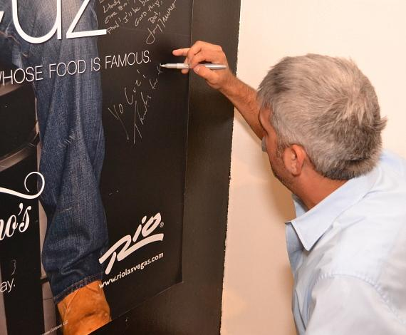 Taylor Hicks signs the Steve Martorano poster at Martorano's