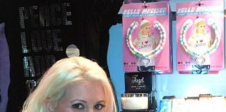 Holly Madison, with a fabulously chic Couture pop, smiling in front of her line of candy necklaces at the new flagship location of Sugar Factory at Paris Las Vegas