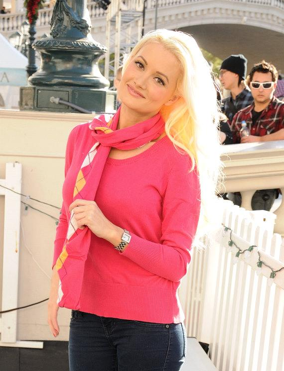 Holly Madison enters the skating rink